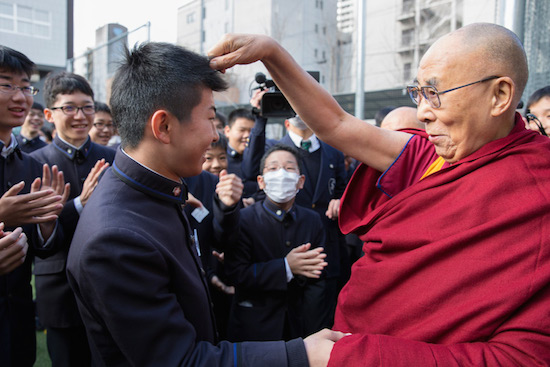 His Holiness the Dalai Lama playfully greeting students on his arrival at Seifu High School in Osaka, Japan on November 10, 2016. Photo/Jigme Choephel