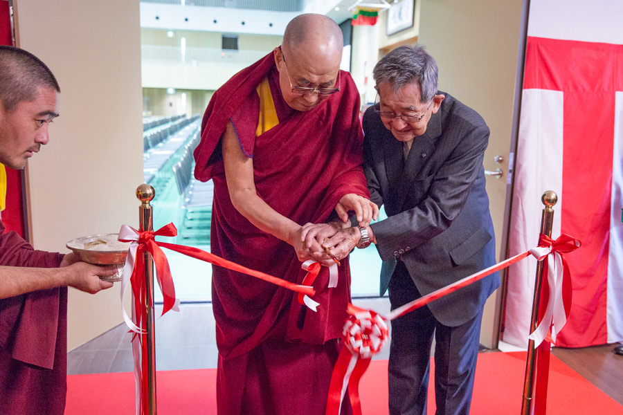 His Holiness the Dalai Lama and School Director Hiraoka Hidenobu cutting the ribbon to inaugurate the new auditorium at Seifu High School in Osaka, Japan on November 10, 2016. Photo/Jigme Choephel