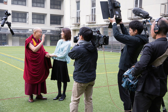 His Holiness the Dalai Lama being interviewed by Tomoko Nagano, anchorperson of Asahi TV's program Hodo Station Sunday during his visit to Seifu High School in Osaka, Japan on November 10, 2016. Photo/Jigme Choephel