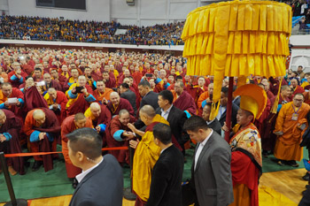His Holiness the Dalai Lama greeting members of the audience as he at the Buyant Uhaa Sports Complex in Ulaanbaatar, Mongolia on November 20, 2016. Photo/Tenzin Taklha/OHHDL