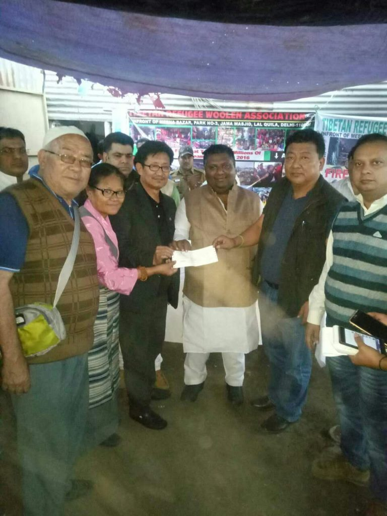 The minister from the Delhi State Government with some of the affected Tibetan shopkeepers.
