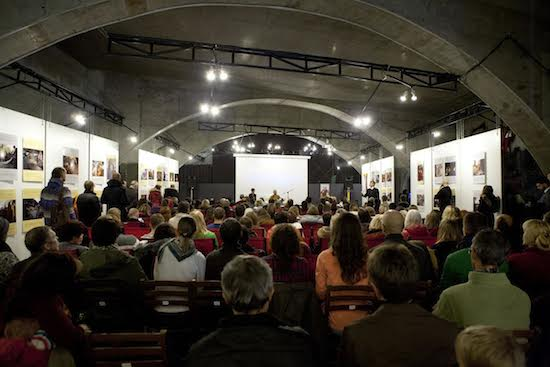 Telo Tulku Rinpoche delivering a public talk on 'Dalai lama: Buddhist principles for the modern world' at the photo exhibition held in Kiev, 2 November 2016