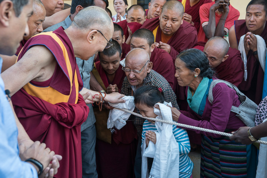 His Holiness the Dalai Lama greeting members of the local community on his way to Drepung Loseling to attend the final day of the Tibet Emory Symposium in Mundgod, Karnataka, India on December 20, 2016. Photo/Tenzin Choejor/OHHDL