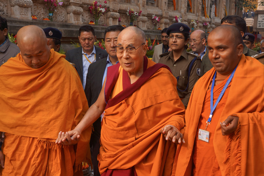 Two monks from the Mahabodhi Society escorting His Holiness the Dalai Lama around the Mahabodhi Temple in Bodhgaya, Bihar, India on December 29, 2016. Photo/Jeremy Russell/OHHDL