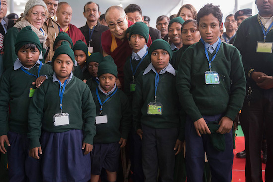 His Holiness with a group of local students who welcomed him before his talk to 2000 Bihari students at the Kalachakra teaching ground in Bodhgaya, Bihar, India on December 31, 2016. Photo/Tenzin Choejor/OHHDL