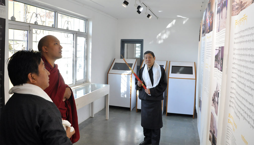 Gyalwang Karmapa Rinpoche viewing a panel on exhibition at Tibet Museum, 14 December 2016.