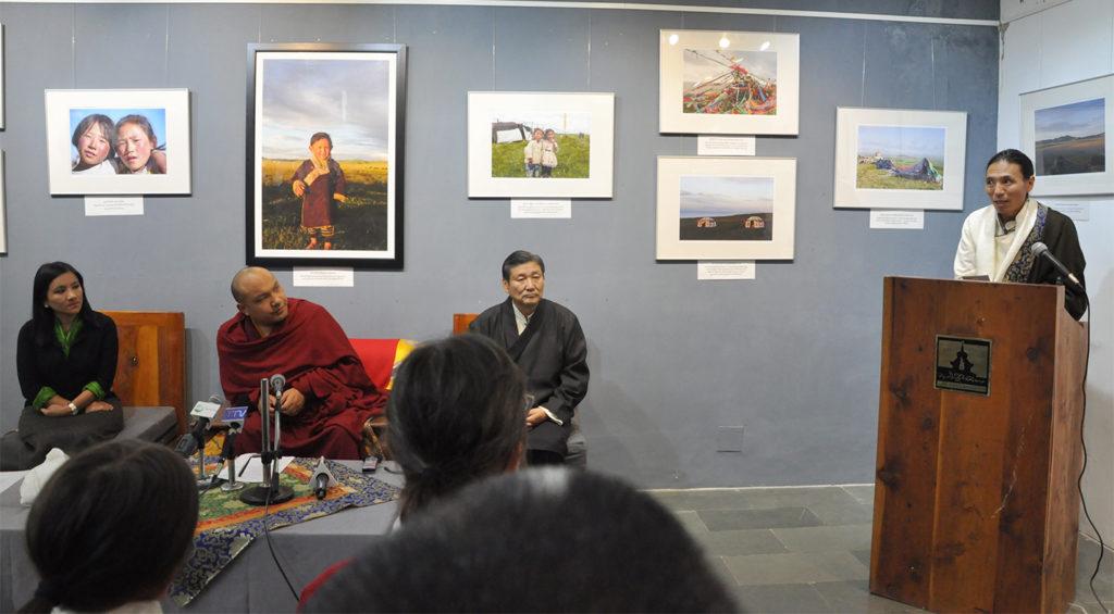 Photographer Kunchok Gyaltsen explaining th photo exhibition at the ceremony, 14 December 2016.