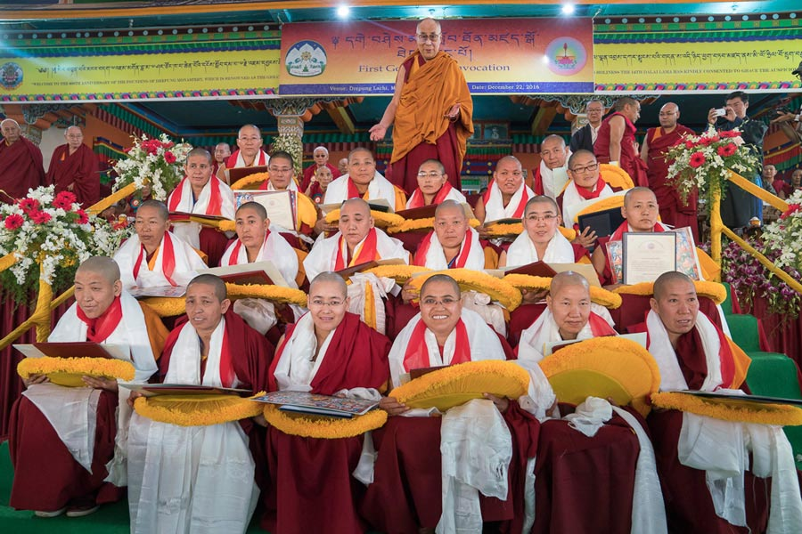Tibetan spiritual leader Dalai Lama poses for a photo with the 20 Tibetan Buddhist nuns who received the Geshema degree, at Drepung monastery, Mundgod, India, on 22 December 2016. Photo @OHHDL