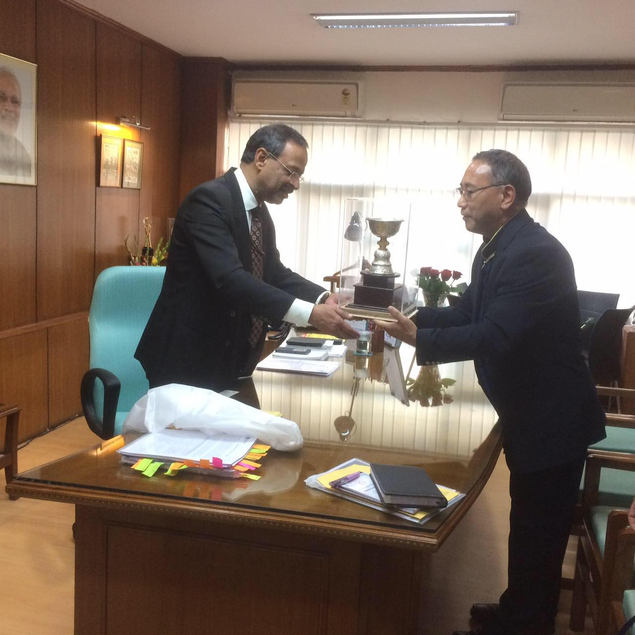 Education Kalon Ngodup Tsering presenting a memento to Mr Anil Swaroop, Education Secretary in the HRD ministry, government of India.