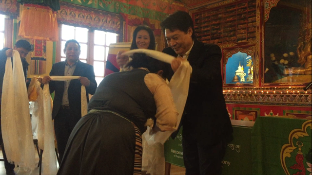Representative Tashi Phuntsok greeting the newly elected President of Brussels chapter of TWA and others.