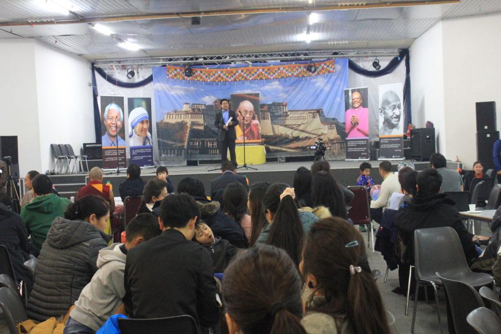 Representative Tashi Phuntsok addressing the children's talent show in Brussels, Belgium.