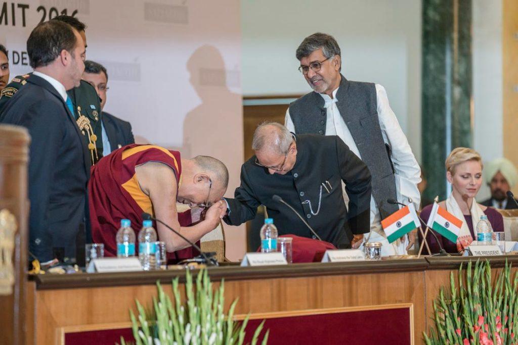 His Holiness the Dalai Lama greets India's President Pranab Mukherjee Photo@Office of Dalai Lama