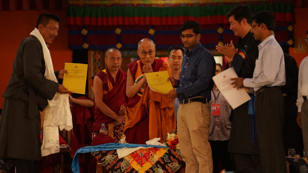 The singing of the agreement between Mr S S Nukul, DC of Karwar, and Mr Karma Gelek, Tbetan settlement officer of Mundgod.