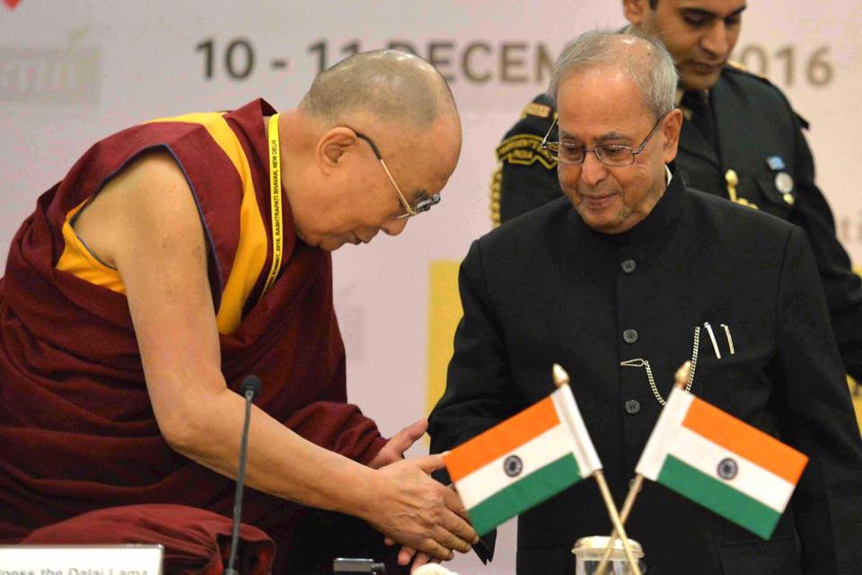 His Holiness the Dalaii Lama greets India's President Pranab Mukherjee. Photo@ President's Office