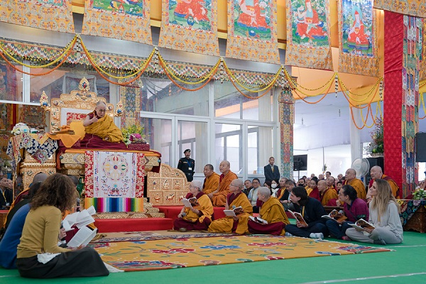 A group of monks, nuns and lay-people reciting the 'Heart Sutra' in Spanish at the start of the third and final day of the actual Kalachakra Empowerment in Bodhgaya, Bihar, India on January 13, 2017. Photo/Tenzin Choejor/OHHDL