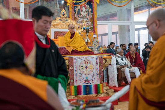 Sikyong Dr Lobsang Sangay and Speaker Khenpo Sonam Tenphel of the Tibetan Parliament standing while Sakya Trizin Rinpoche recites the Long life ritual prayers.