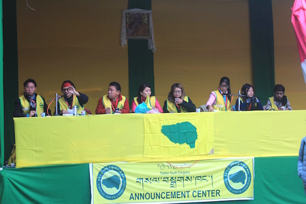 TYC volunteers making announcements in 8 different languages, near the main Mahabodhi temple in Bodh Gaya,