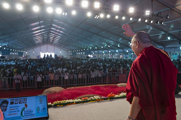His Holiness the Dalai Lama waving to the audience of over 10,000 at the National Women�s Parliament's inaugural ceremony in Amaravati, Andhra Pradesh, India on February 10, 2017. Photo by Tenzin Choejor/OHHDL