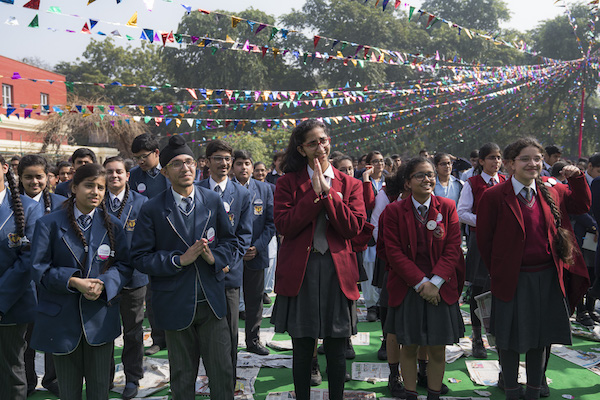 Students from more than 80 schools gathered at the Convent of Jesus & Mary, greets His Holiness the Dalai Lama as he ascends the stage.
