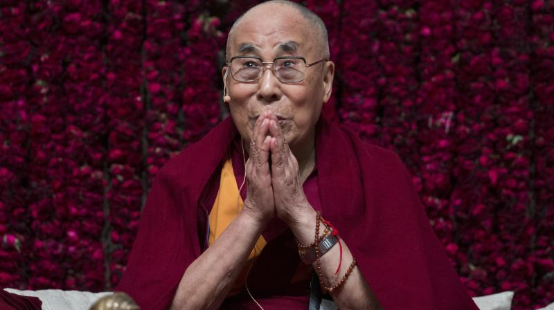 "Tibetan spiritual leader the Dalai Lama gestures as he speaks on ""Reviving Indian Wisdom in Contemporary India' at a public event in New Delhi on Sunday. (Photo: PTI)"