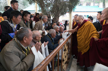 His Holiness the Dalai Lama greeting members of the crowd gathered in the courtyard as he makes his way to the Main Tibetan Temple for the first day of his two day teaching in Dharamsala, HP, India on March 13, 2017. Photo by Tenzin Choejor/OHHDL