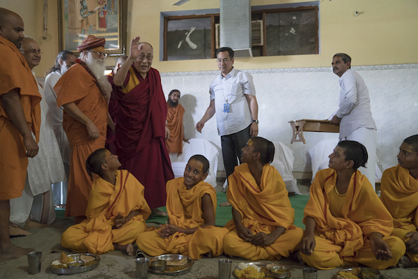 His Holiness the Dalai Lama arriving to participate in the community lunch (dham) during his visit to the Sri Udasin Karshni Ashram on March 20, 2017 in Mathura, Uttar Pradesh, India. Photo by Tenzin Choejor/OHHDL