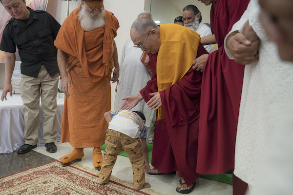 A young child greeting His Holiness the Dalai Lama as he arrives to meet with members of the media at the Sri Udasin Karshni Ashram on March 20, 2017 in Mathura, Uttar Pradesh, India. Photo by Tenzin Choejor/OHHDL