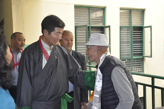 SIkyong interacting with an 82 year old resident of the Old Age Home based in Rajpur, 31 March 2017.