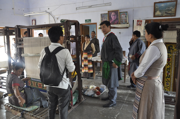 Sikyong inspecting carpet weaving at the Tibetan Women's Center in Rajpur, 31 March 2017.