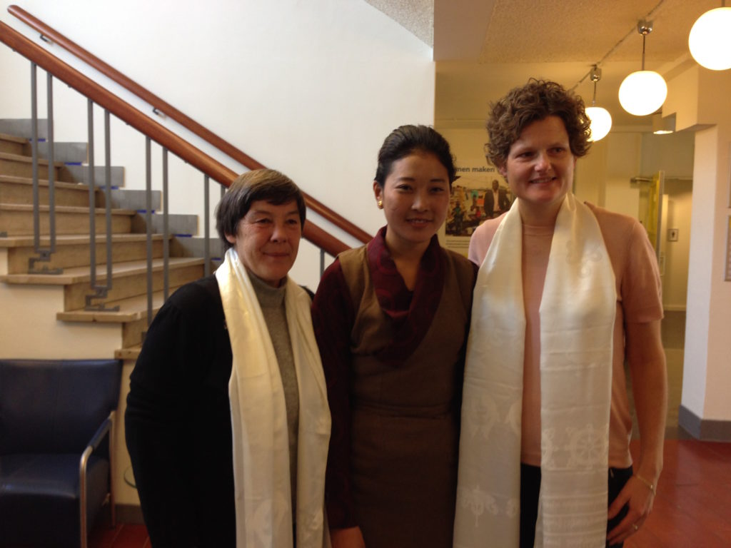Nyima Lhamo with the Amnesty officials
