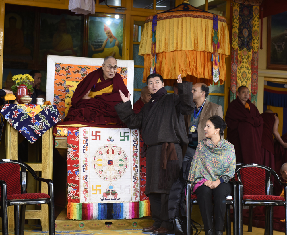 Sikyong Dr. Lobsang Sangay explaining the Women's Empowerment Logo to His Holiness the Dalai Lama