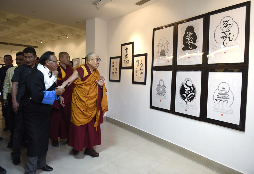 His Holiness the Dalai Lama viewing an exhibition of Tibetan calligraphy by Mr Jamyang Dorjee at the Rajgir International Convention Centre in Rajgir, Bihar, India on 17 March 2017. Photo/Tenzin Phende/DIIR