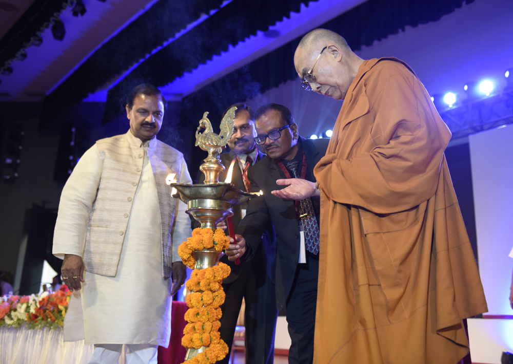 His Holiness the Dalai Lama and Union Minister of State for Culture & Tourism Dr Mahesh Sharma lighting the ceremonial lamp to inaugurate the International Buddhist Conference in Rajgir, Bihar, India on 17 March 2017. Photo/Tenzin Phende/DIIR