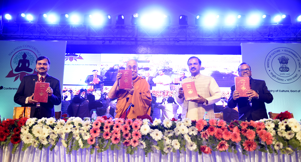 His Holiness the Dalai Lama releasing a newly printed edition of the Pali Tripitaka in Devanagari script published by the Ministry of Culture during the inaugural session of the International Buddhist Conference in Rajgir, Bihar, India on 17 March, 2017. Photo/Tenzin Phende/DIIR