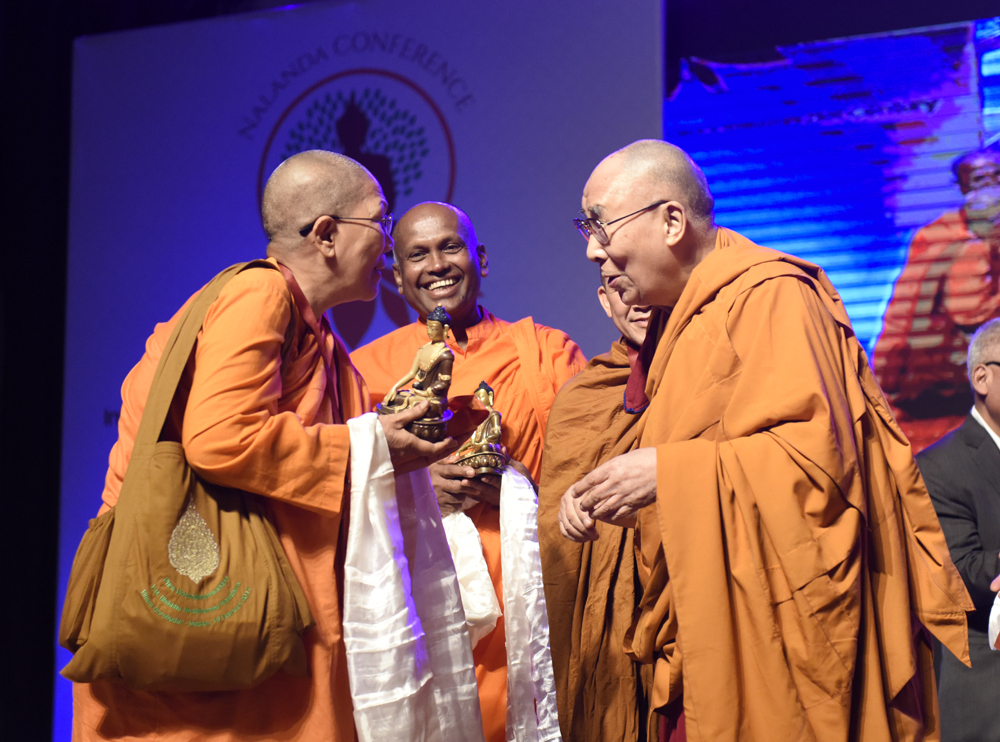 His Holiness the Dalai Lama offering Buddha statues to senior members of Sangha attending the three-day International Conference on Buddhism at the Rajgir International Convention Centre in Rajgir, Bihar, India on 18 March 2017. Photo/Tenzin Phende/DIIR
