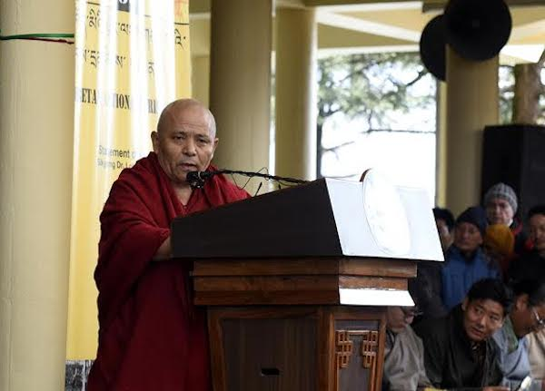 Deputy Speaker Acharya Yeshi Phuntsok reading the statement of the Tibetan Parliament in exile.