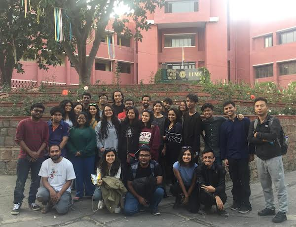 Group photo infront of IIMC.