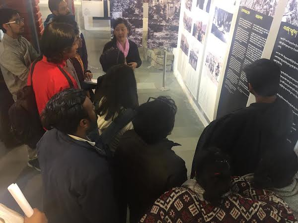 Ms Lhamo Tsering briefing the students at Tibet Museum.