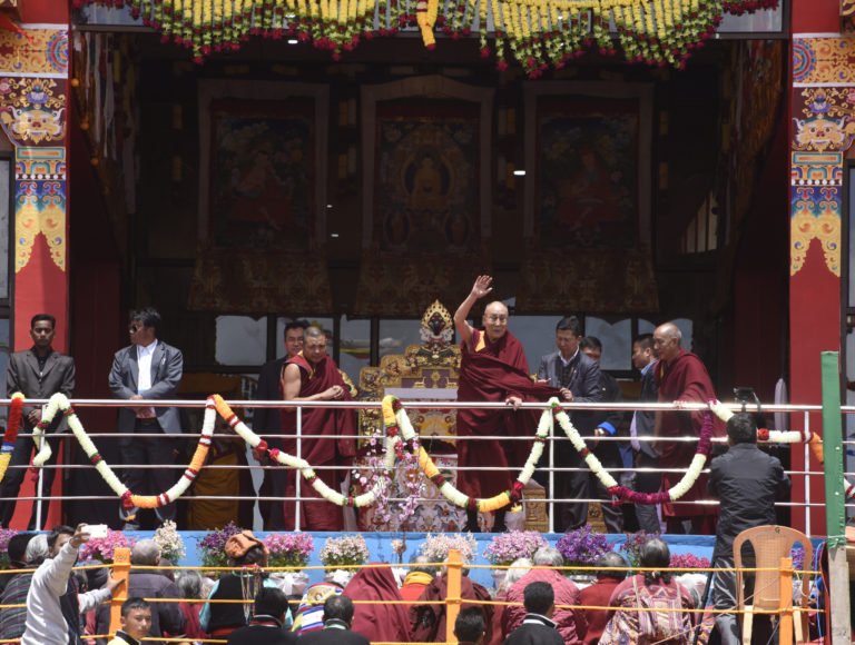 His Holiness the Dalai Lama waves to the crowd at the first day of teachings at Tawang monastery, 8 April 2017.