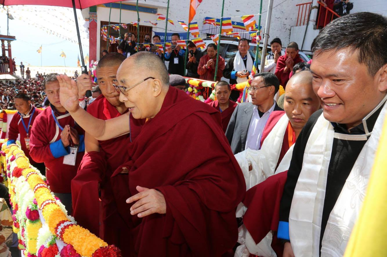 His Holiness the Dalai Lama greets his followers and devotees before departing for Assam, 11 April 2017.