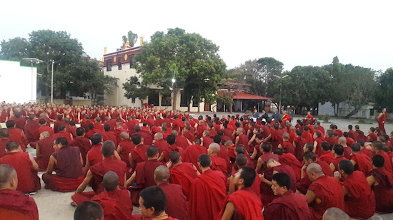 Tibetan Buddhist monks listening to Home Kalon.