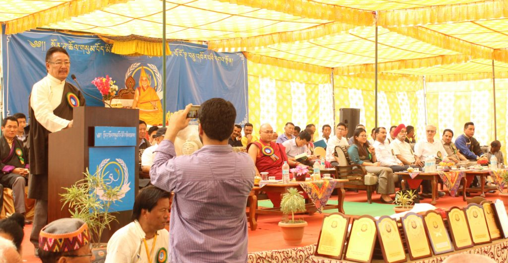 Home Kalon Addressing the public at the golden jubilee celebration of Paonta Cholsum Tibetan settlement.
