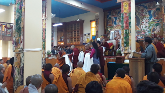 Kalon Karma Gelek Yuthok conferring certificates to the graduating students.