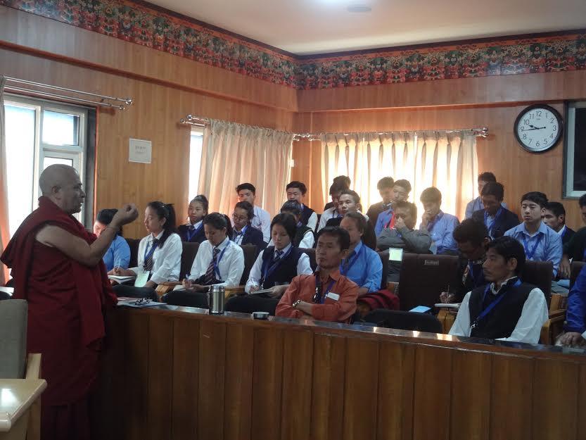 Deputy Speaker Acharya Yeshi Phuntsok speaking to the students.