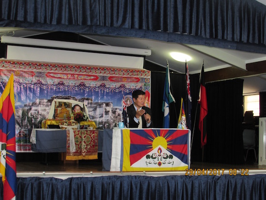 Sikyong addressing the Tibetan community.