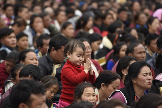 A young devotees offering prayers to His Holiness the Dalai Lama, Dirang Arunahcal Pradesh.