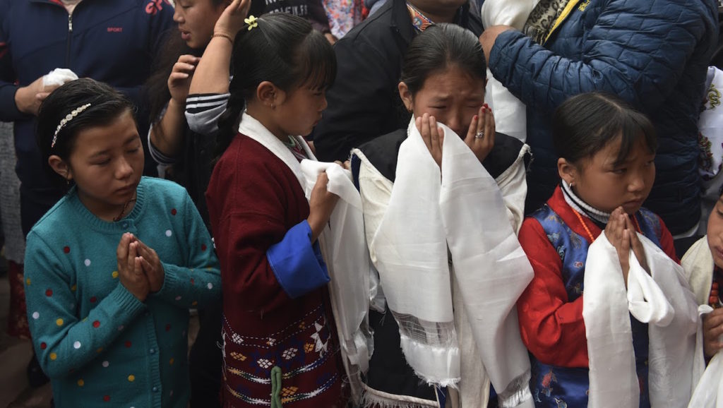 Young girls shed tears of joy in seeing their 'Living God.' Photo @ Jamyang Tsering, DIIR