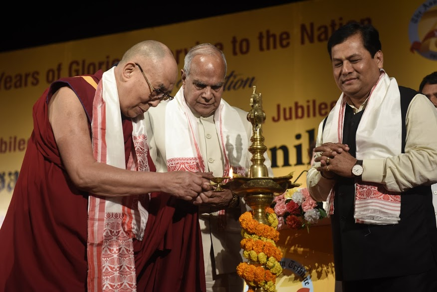 His Holiness the Dalai Lama, Governor of Assam Shri Banwarilal Purohit and Chief Minister of Assam Sarbananda Sonowal lighting a traditional lamp to inaugurate the Platinum Jubilee Celebration of the Assam Tribune at Pragjyoti ITA in Guwahati, Assam, 1 April 2017. Photo by Jayang Tsering/DIIR.