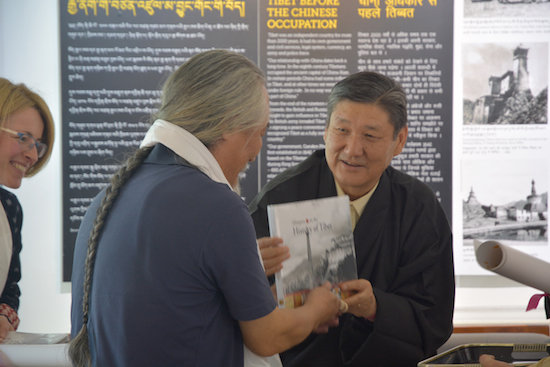 Secretary Sonam Norbu Dagpo presenting a book to thank Mr Tashi Tsering for his artistic contributions towards the exhibition.