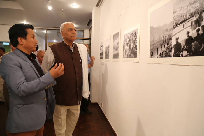 Tibet Museum Director Tashi Phuntsok guides Shri Yashwant Sinha at the inauguration of Photo Exhibition on 'Revisiting Cultural Revolution in Tibet.'